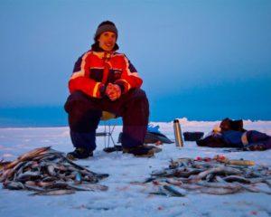 Ice-hole fisher on the Ladoga Lake